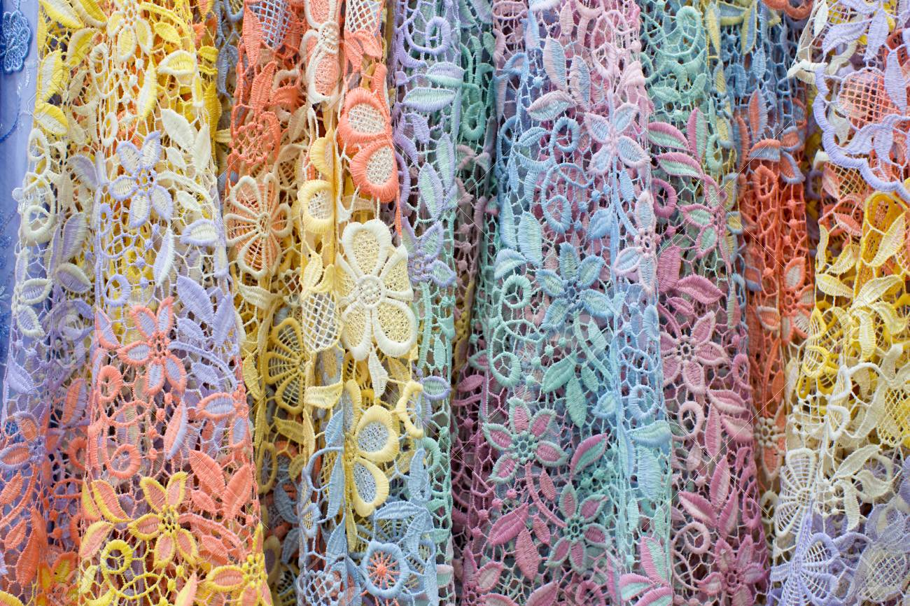 52751841-display-of-pile-of-colorful-lace-fabric-
